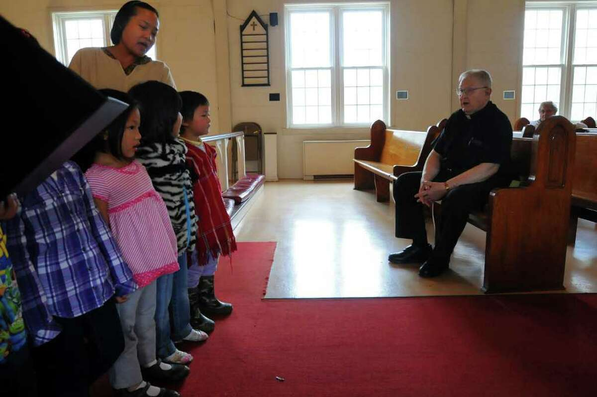 The Rev. James H.B. Kenyon celebrated the 60th anniversary of his ordination, during a service and fellowship afterwards at St. David's Church in Castleton, NY on Sunday November 28, 2010. Children from the Sunday school sing to him. ( Philip Kamrass / Times Union )