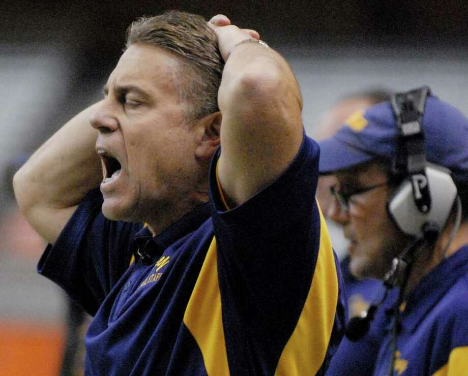 High school football -- Troy coach Jack Burger reacts on the sidelines with his team behind late in the fourth quarter against Rush-Henrietta.   (Luanne M. Ferris / Times Union) Photo: Luanne M. Ferris