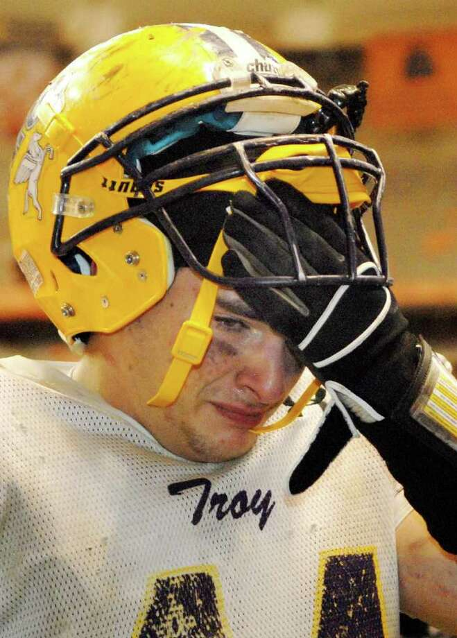 High school football -- Troy's Kyle Geraci is emotional leaving the field after the Flying Horses lost to Rush-Henrietta.  (Luanne M. Ferris / Times Union) Photo: Luanne M. Ferris