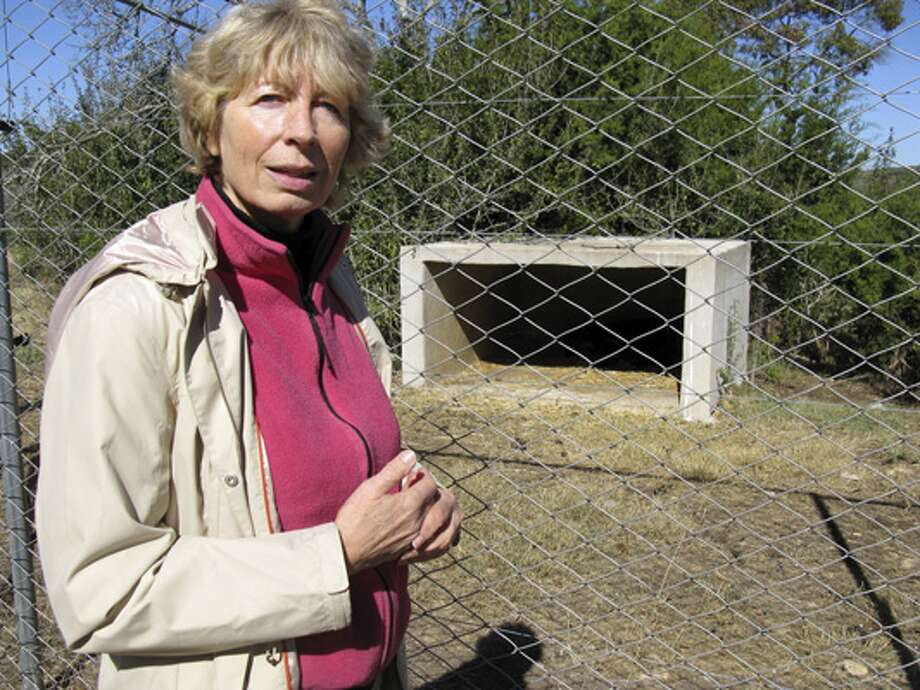 Wildlife Rescue & Rehabilitation founder Lynn Cuny shows one of the animal enclosures at the Kendalia facility.