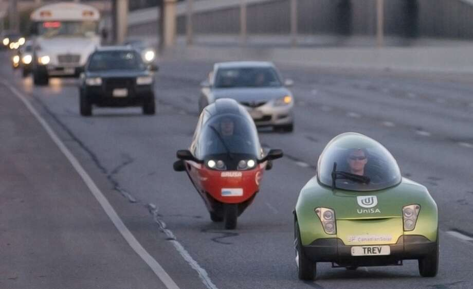 Electric vehicles zip along Interstate 10 early Sunday as part of the Zero Race. The drivers, who started in Switzerland, are headed for the United Nationas Climate Change Conference in Cancún, Mexico, this week.