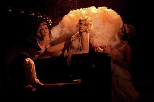 Christina Aguilera (center) stars in Screen Gems' BURLESQUE. Photo: STEPHEN VAUGHAN, BURLESQUE / DF-12255