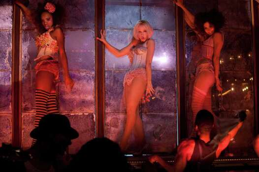 Christina Aguilera (center) stars in Screen Gems' BURLESQUE. Photo: STEPHEN VAUGHAN, BURLESQUE / DF-10436