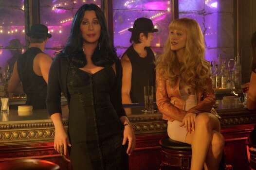 Cher (left) and Christina Aguilera star in Screen Gems' BURLESQUE. Photo: STEPHEN VAUGHAN, BURLESQUE / DF-33190