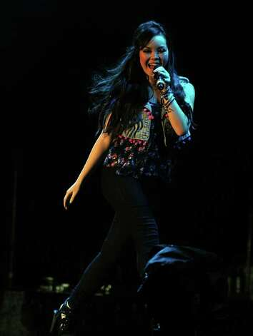 US singer Demi Lovato, performs at the stage at the Ricardo Saprissa Stadium during a concert in San Jose on October 26, 2010.AFP  PHOTO/ Yuri CORTEZ (Photo credit should read YURI CORTEZ/AFP/Getty Images) Photo: YURI CORTEZ, Staff / AFP