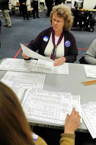 Jean de Smet of Willamantic inspects individual election ballots prior to the recount at City Hall Annex in Bridgeport, Conn. Nov. 30th, 2010. Photo: Ned Gerard / Connecticut Post