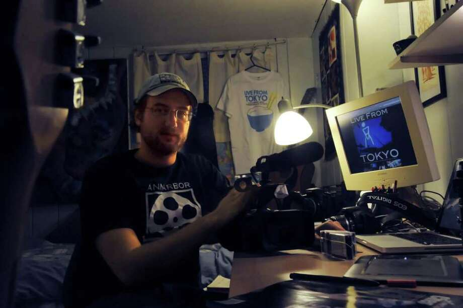 Ian Sotzing, who has done film work for a documentary on the Japanese underground music scene, sits in his Old Greenwich home, on Monday, Nov. 29, 2010. Photo: Helen Neafsey / Greenwich Time
