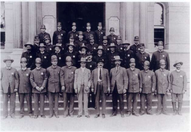 Chief Detective George C. Shoaf appears in plainclothes (front row, far left) with the San Antonio police force in 1900 or 1901.