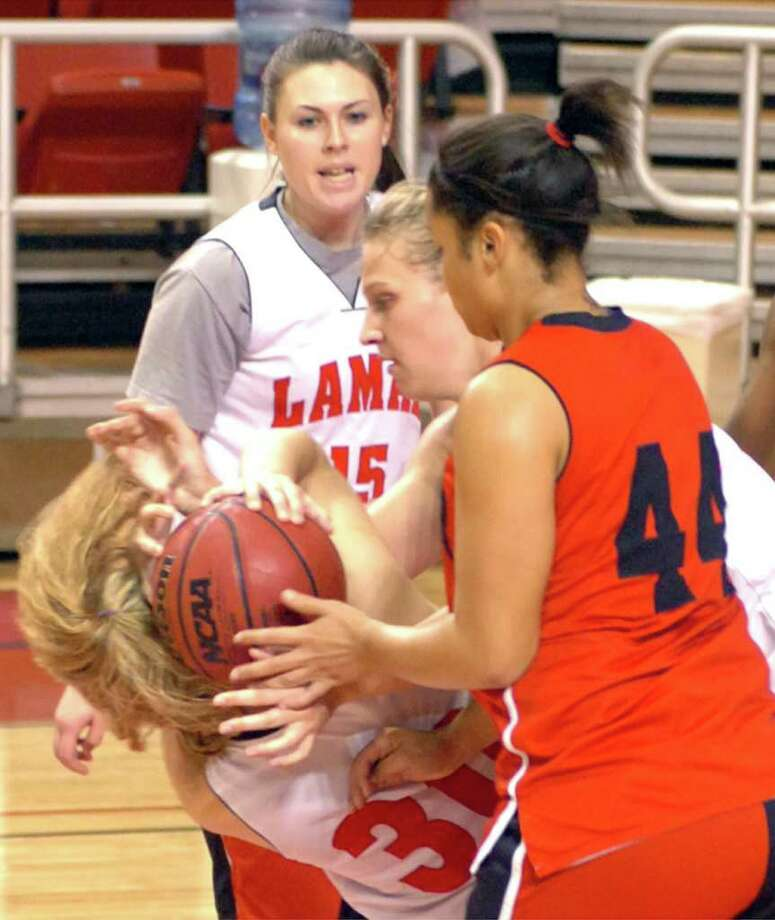 A flock of Lady Cardinals battle for a rebound during the team's scimmage at practice Monday. Pete Churton/The Enterprise Photo: Pete Churton / Beaumont