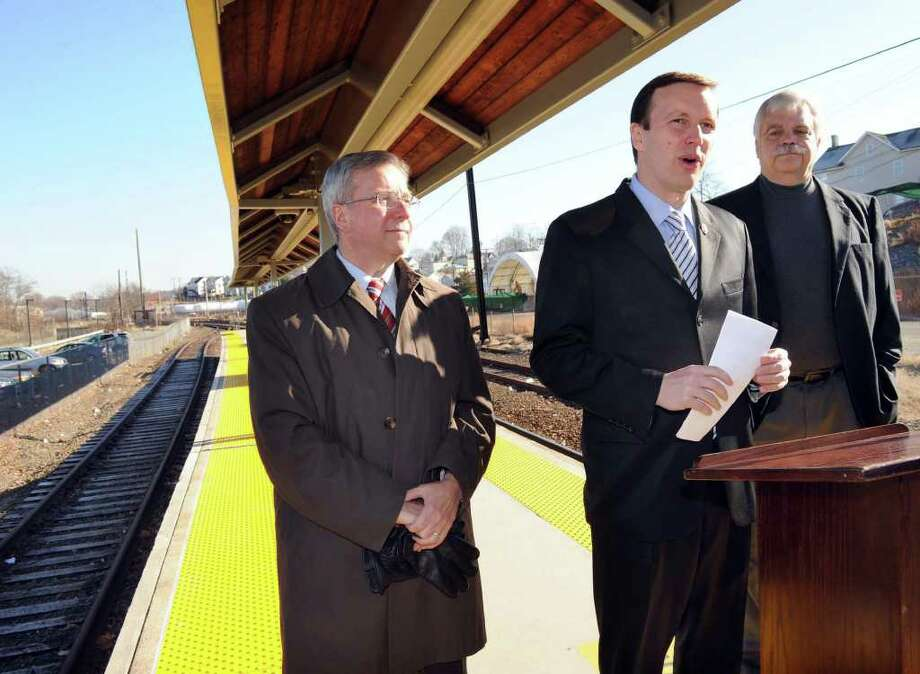U.S. Rep. Chris Murphy, center, flanked by Bethel First Selectman Matt Knickerbocker, left and state Rep. Bob Godfrey, speaks at a press conference he called at the Danbury train station to address recent remarks by Gov. M. Jodi Rell about closing the Danbury line. Photo taken Monday, Nov. 29, 2010. Photo: Carol Kaliff / The News-Times