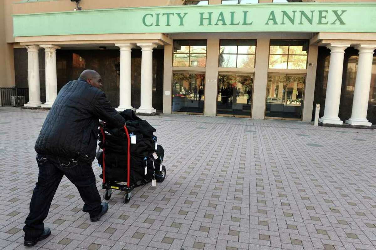 Ken Garner from the Bridgeport Registrar of Voters office pushes a dolly loaded with bags containing election ballots into City Hall Annex in Bridgeport, Conn. Nov. 30th, 2010.