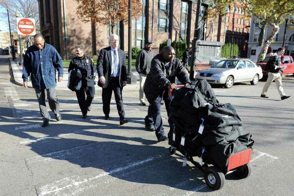 Ken Garner from the Bridgeport Registrar of Voters office pushes a dolly loaded with bags containing election ballots from McLevy Hall to City Hall Annex in Bridgeport, Conn. Nov. 30th, 2010.
