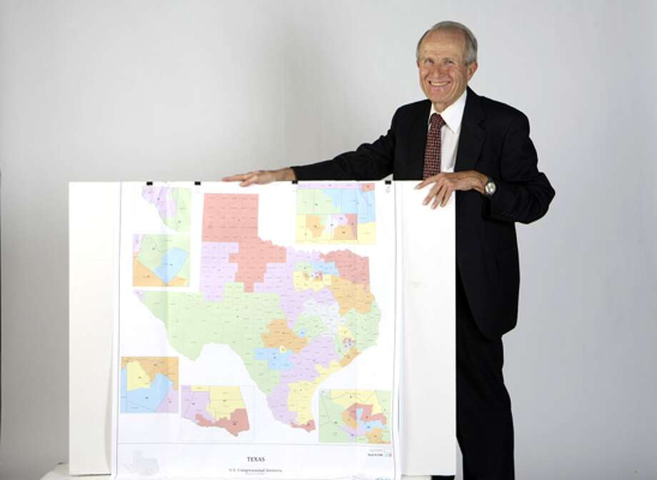 Bill Owens on Nov. 11 shows a redistricting plan he devised.