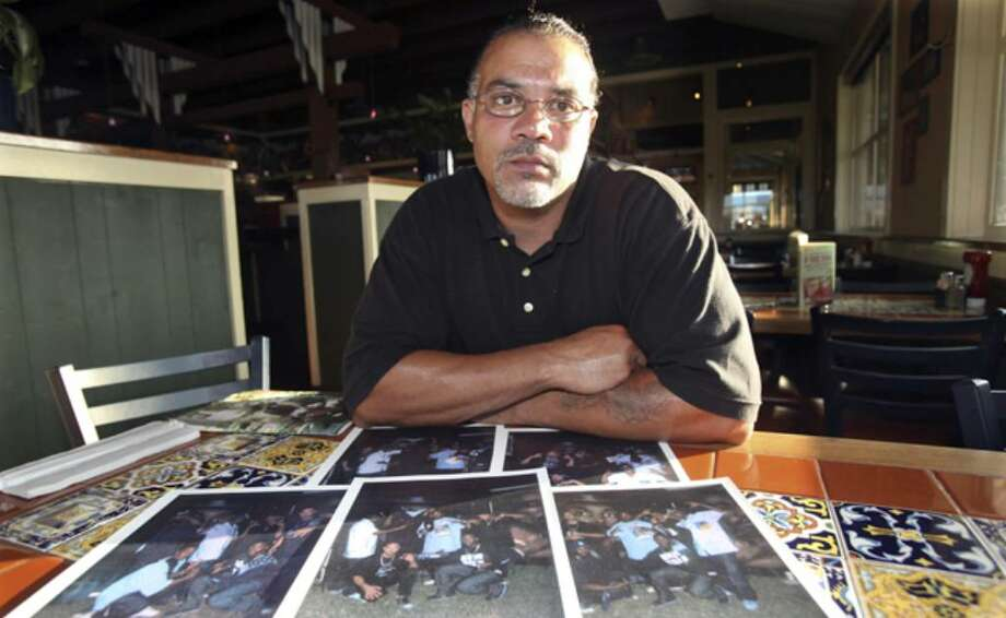 William Tutt displays photographs from his days as a gang leader.