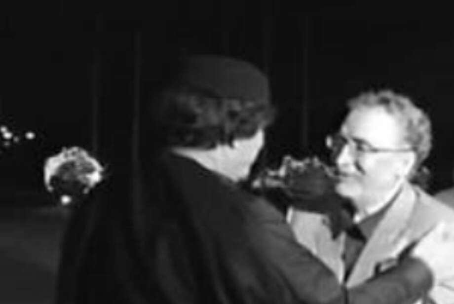 In an image made from television, Abdel Baset al-Megrahi (right), who was found guilty of the 1988 Lockerbie bombing, is greeted by Libyan leader Moammar Gadhafi, in Tripoli, Libya, on Aug. 21. A crowd at al-Megrahi's arrival cheered him like a hero.