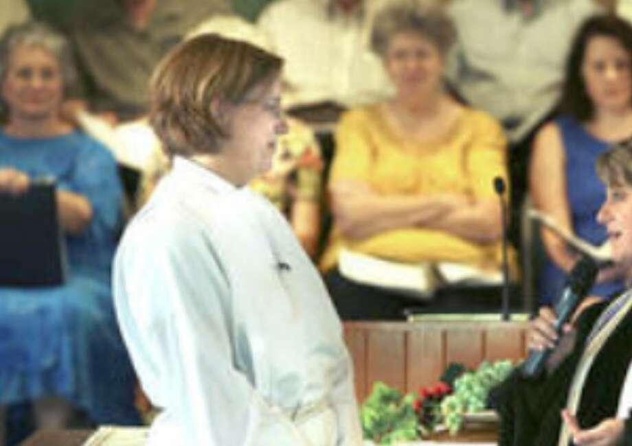 The Rev. Kelly S. Allen (left) listens to Rabbi Allison Bergman Vann of Temple Beth-El at Allen's installation as pastor of University Presbyterian Church Aug. 30.