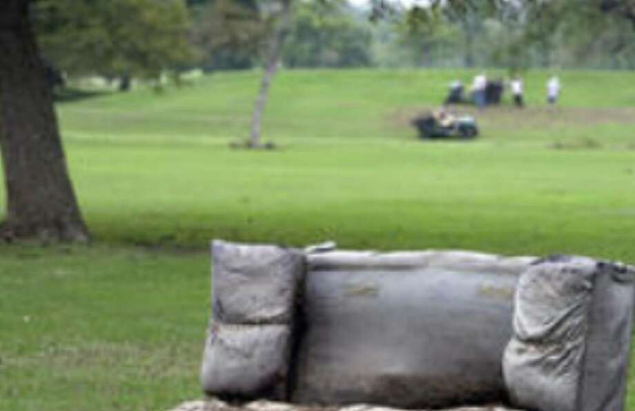 An old couch was left washed up in the rough on one of the holes at Olmos Basin Golf Course after heavy weekend rain flooded the area.
