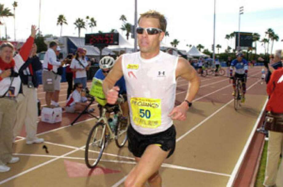 Josh Cox, running in an earlier Rock 'n' Roll marathon in Arizona, is the American record-holder in the 50K.