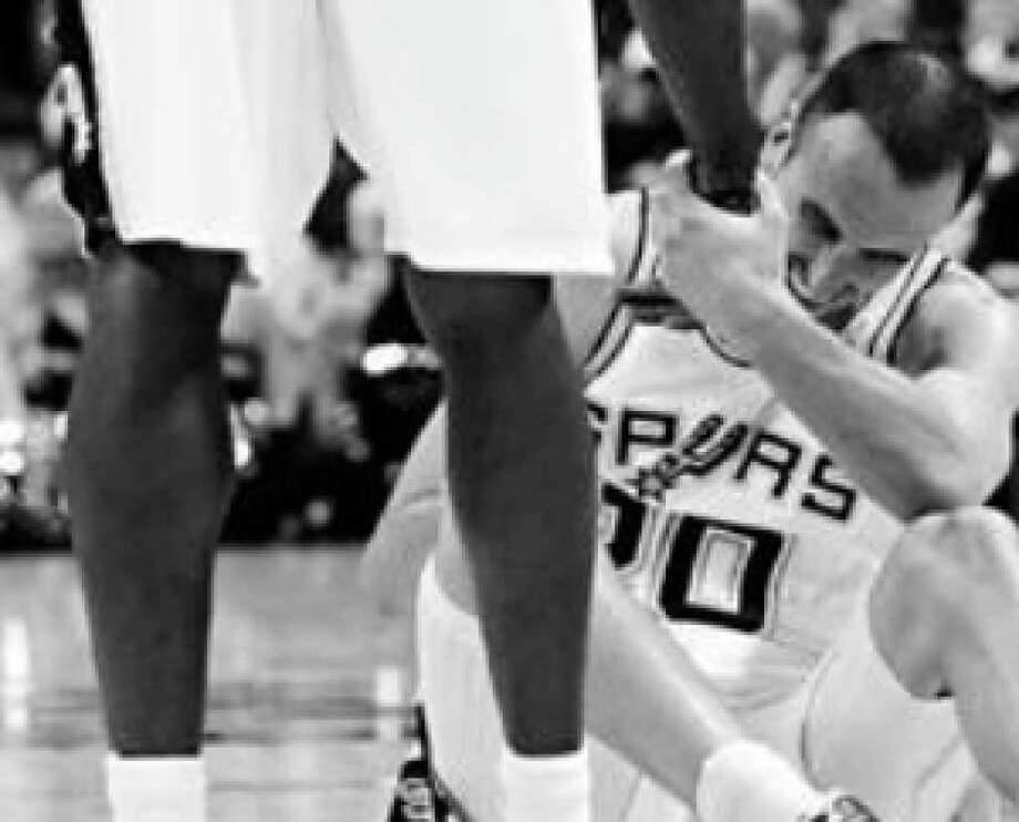 Spurs guard Manu Ginobili, being helped up by Antonio McDyess, sat out the fourth quarter with a tight hamstring because Gregg Popovich didn't want to risk further injury.