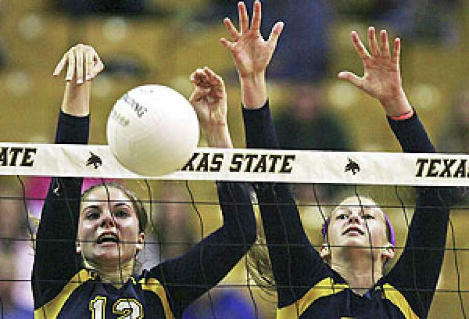 Jordan Kotara (left) and Tara Dunn dominate at the net with blocks during Poth's 25-22, 25-23, 25-18 sweep of White Oak in the 2A semifinals at Strahan Coliseum in San Marcos.