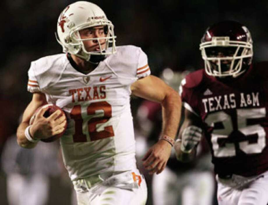 UT quarterback Colt McCoy outruns A&M's Jordan Pugh for a 65-yard touchdown run in the first half. He ran for 175 yards and threw for 304.