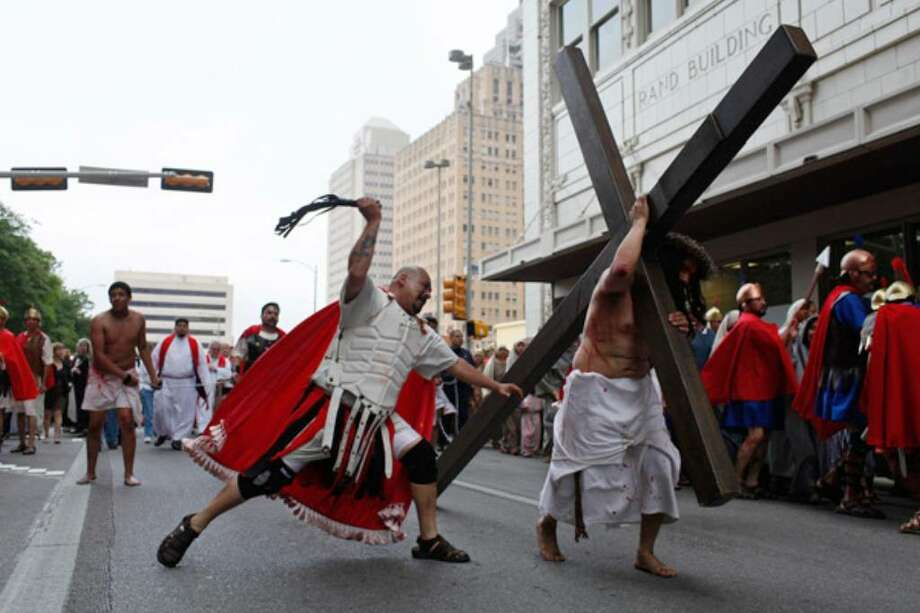 Playing a Roman soldier, Antonio Perez whips Jesus, portrayed by Victor Villaseñor, during the Passion play that involved 130 parishioners from San Fernando Cathedral and other Catholic churches.