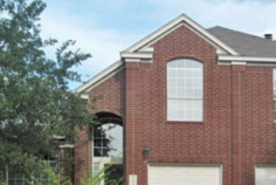 This 2,240-square-foot brick home in Mount Arrowhead of Stone Oak is listed for $182,000.