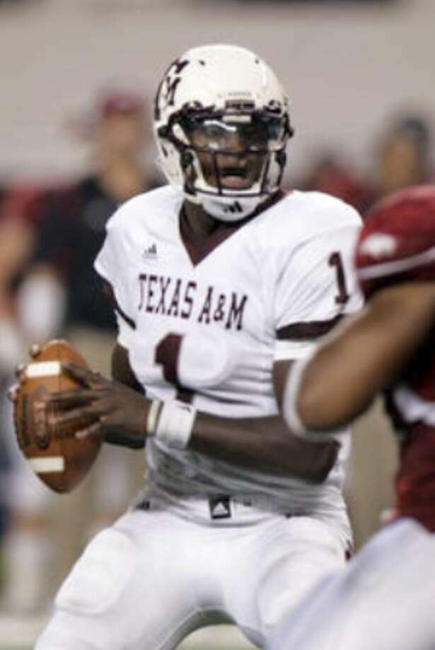 Texas A&M's Jerrod Johnson looks to make a play in the fourth quarter against Arkansas, long after the outcome of the game had been decided. The Aggies quarterback went 30 of 59 for 348 yards and two touchdowns and no interceptions, but he did lose two fumbles.
