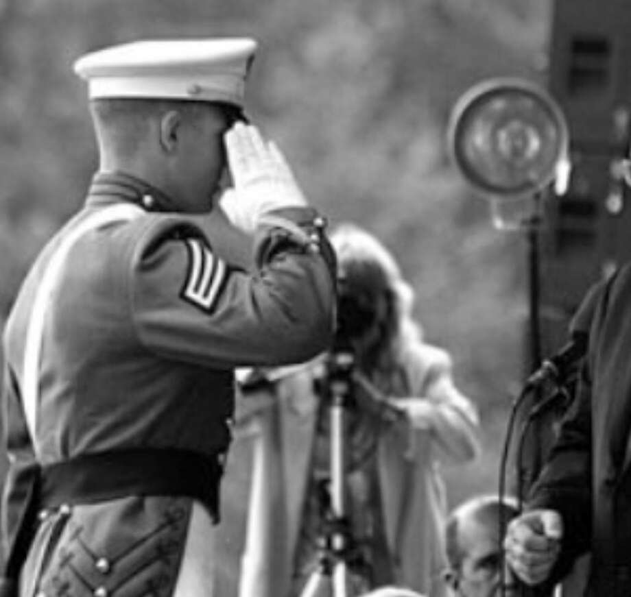 A graduating West Point cadet salutes ex-Vice President Dick Cheney, who  gave the 2007 graduation address to 978 cadets. A reader says Cheney is a saber-rattler despite his many military-service  deferments.