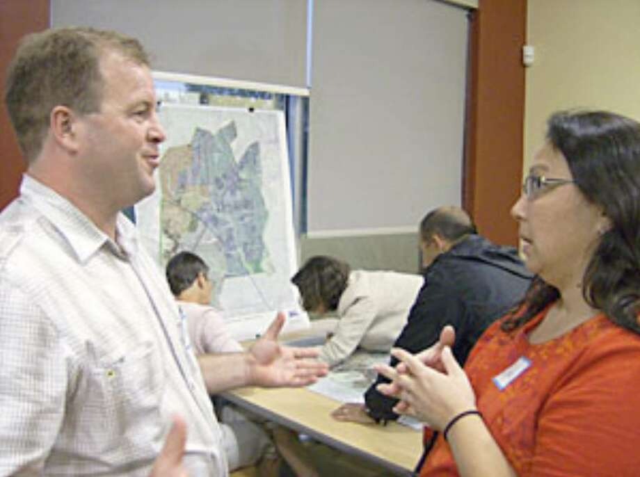 Sonoma Ranch resident Robert Davidson chats with Dede Goethke (who lives in the Stinson Middle School area) during a Walkable Community Workshop held Oct. 22 at the John Igo Library. Davidson, an avid biker rider and walker, identified possible biking and walking connections between neighborhoods in his area and gave that data to the MPO allowing it to call a workshop that attracted about 50 people.