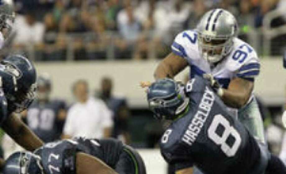 Seahawks quarterback Matt Hasselbeck is hit by Cowboys defensive end Jason Hatcher. Dallas posted three sacks Sunday.