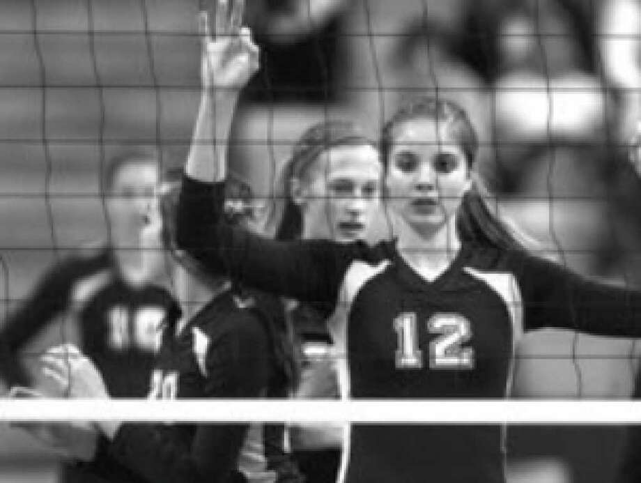 Poth's Jordan Kotara signals her teammates before a serve during the Pirettes Class 2A semifinal victory over White Oak on Thursday at the state volleyball tournament.