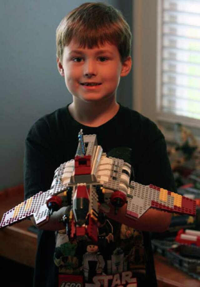 """His father calls 6-year-old Robert Richardson — shown at home with one of his latest Lego spacecraft creations — """"a commercial for Legos."""""""