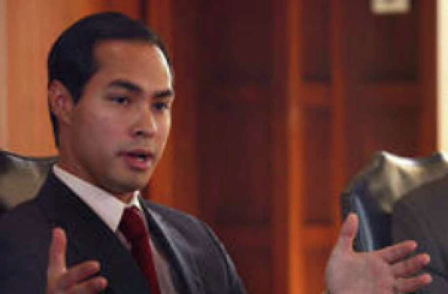Mayor Julián Castro makes a point during an Express-News Editorial Board meeting; CPS interim general manager Steve Bartley listens. Two readers give Castro raves for using restraint on the CPS Energy nuclear-power plan.