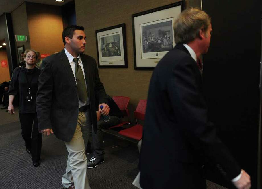 James Guedry follows his attorney, Mitch Adams, into Judge John Steven's court room to begin his trial  Monday. Guedry is the second Beaumont police officer to stand trial for official oppression against Derrick Newman. Guedry is said to have used a Taser on Newman two times during the videotaped incident that occurred Aug. 24, 2007. Guiseppe Barranco/The Enterprise Photo: Guiseppe Barranco / Beaumont