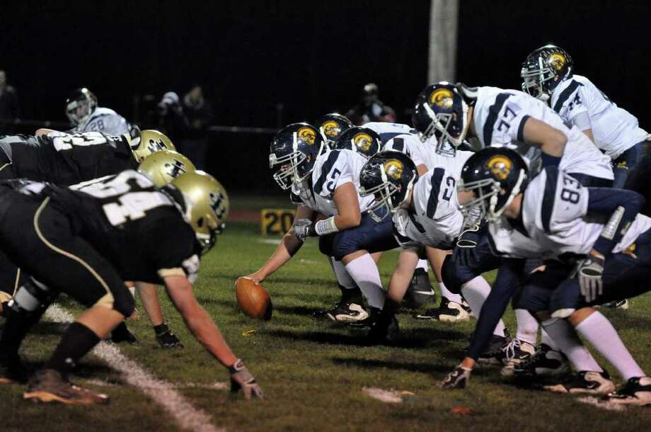 Weston, at right, faces off against Joel Barlow during the football game at Barlow in Redding on Wednesday, Nov. 24, 2010. Photo: Amy Mortensen / Connecticut Post Freelance