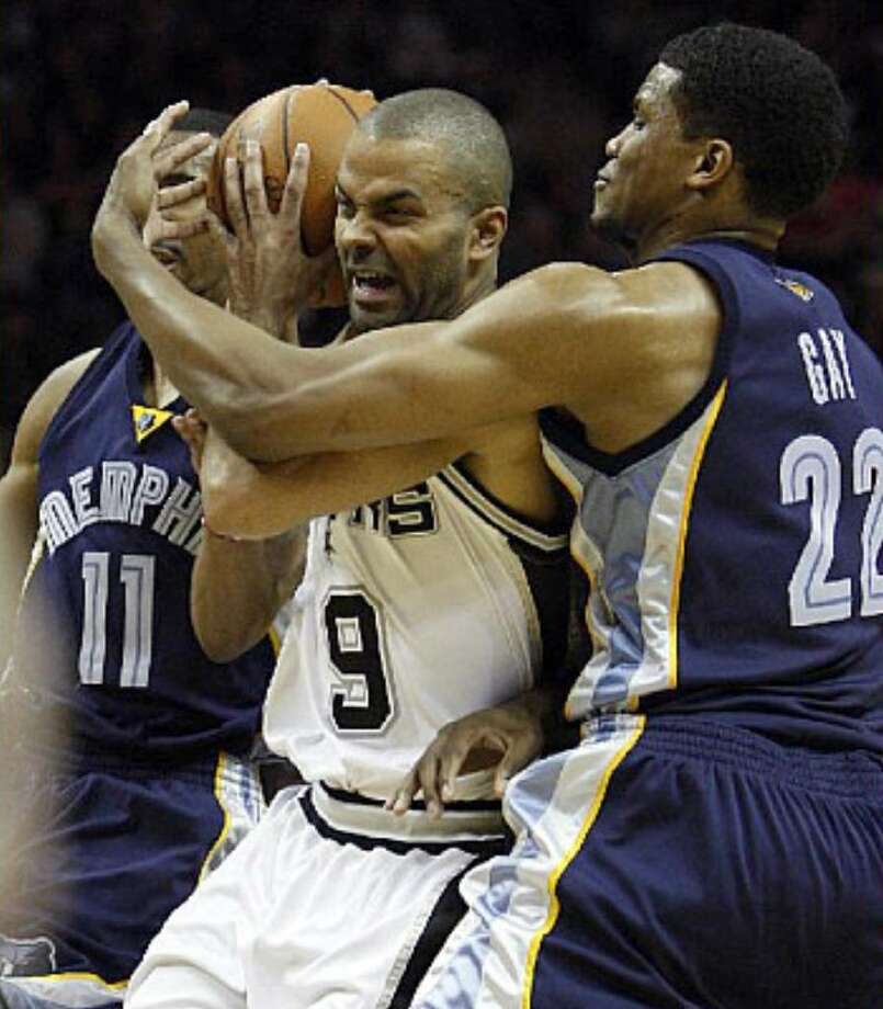 Spurs guard Tony Parker (center) is bottled up by Grizzlies defenders Rudy Gay and Mike Conley during the first half. Parker had 13 points and eight assists in almost 26 minutes.
