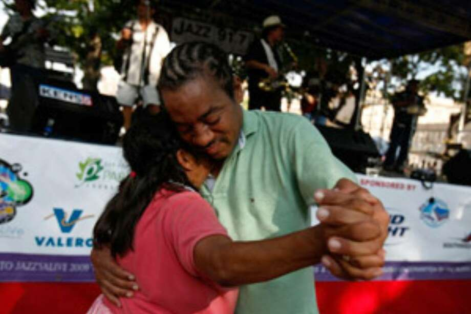 Dario Stanley and his partner dance to the music of Sax On Da Beach during Jazz'SAlive at Travis Park.