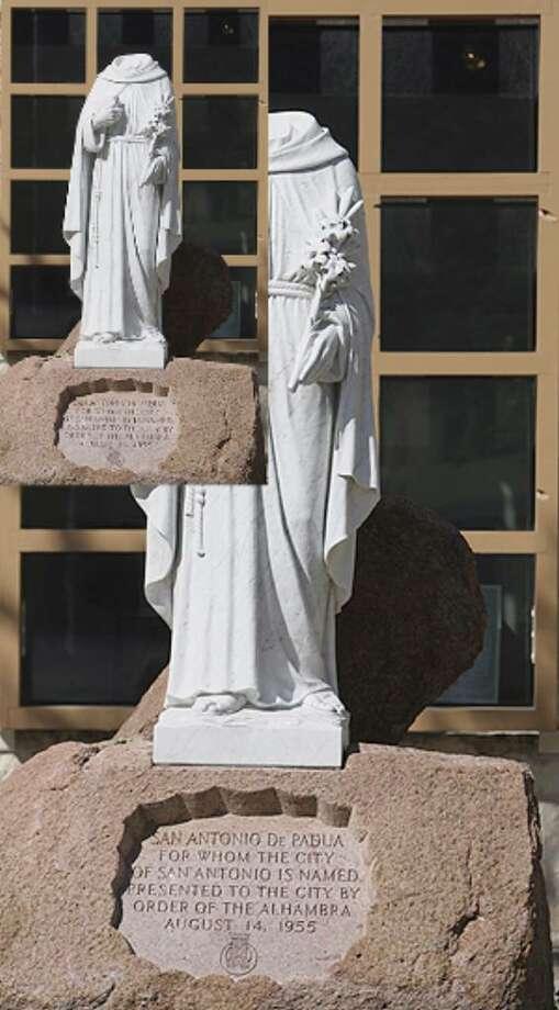 A statue of San Antonio De Padua made of Italian marble stands headless in Main Plaza Sunday near San Fernando Cathedral.