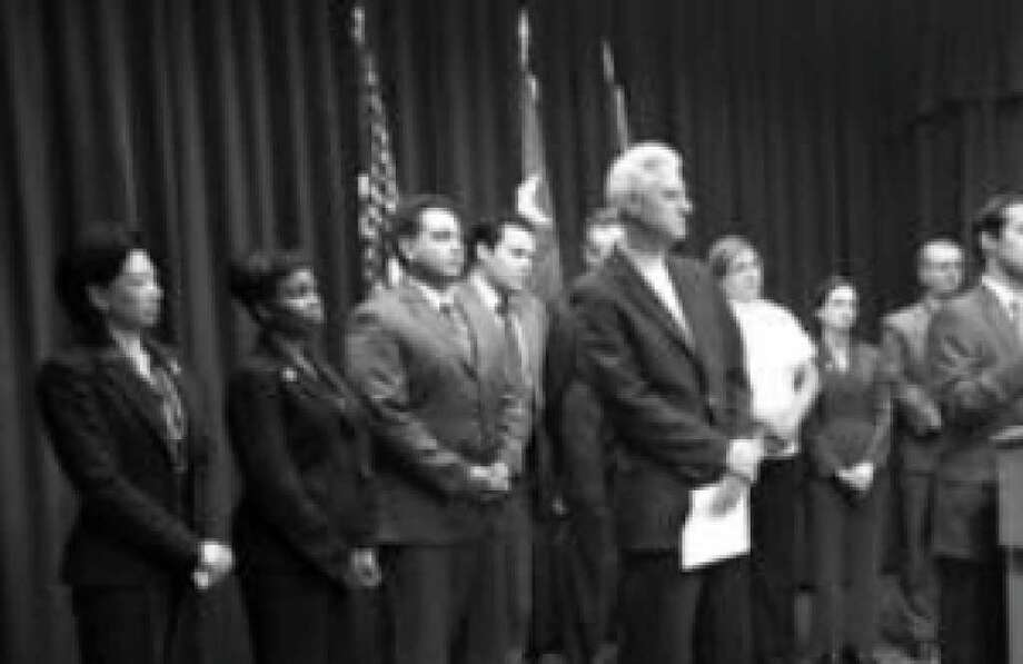 San Antonio Mayor Julián Castro (at lectern), CPS Energy executive Steve Bartley and members of the City Council announce at a joyless Oct. 27 news conference that the price of nuclear expansion just went up by $4 billion. The news has drawn brickbats from Express-News letter writers and others.