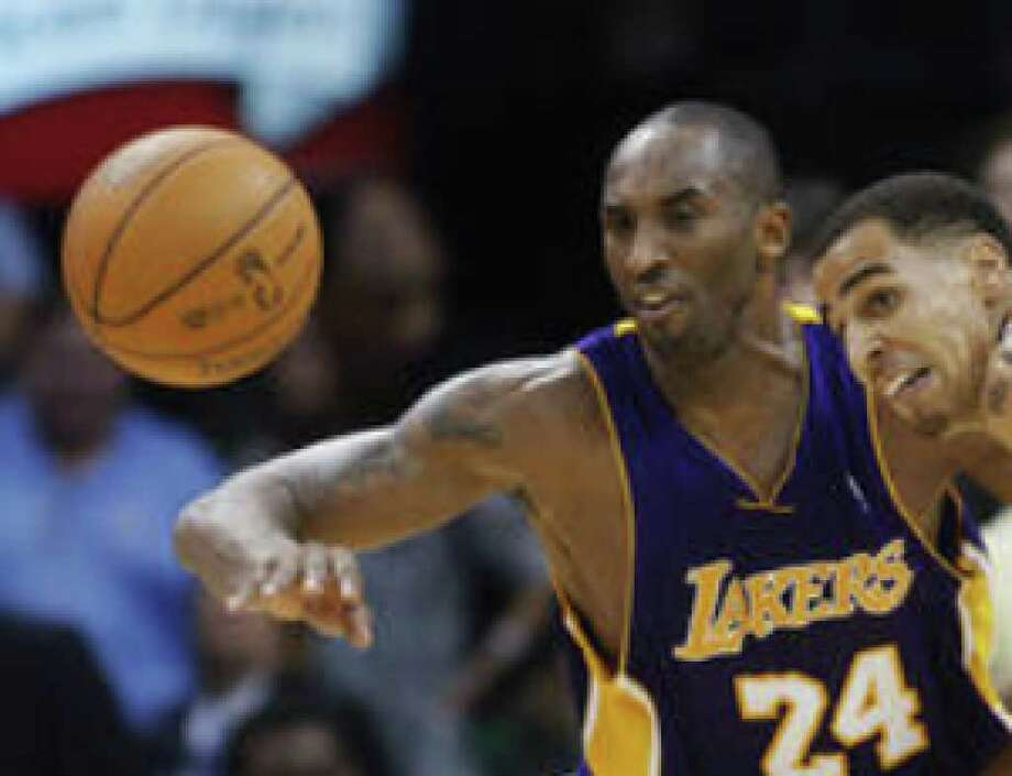 Kobe Bryant (left) kept Thabo Sefolosha and the Thunder at bay Tuesday despite concerns earlier that he had H1N1.