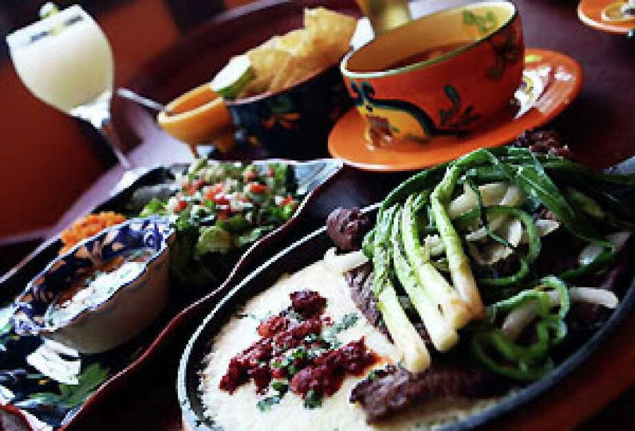The Vaca Naca Special (steak with miniqueso fundido on the same sizzling platter) is one of the menu highlights at La Vaca Naca.