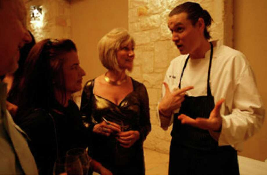 """Chef Jason Dady (right) of Restaurant Insignia and several other local eateries chats with (from left) Doug Anderson, Carol Anderson and Betty Feldman at the popular Grand Tasting. """"Look at the line,"""" Dady said. """"It's crazy."""""""