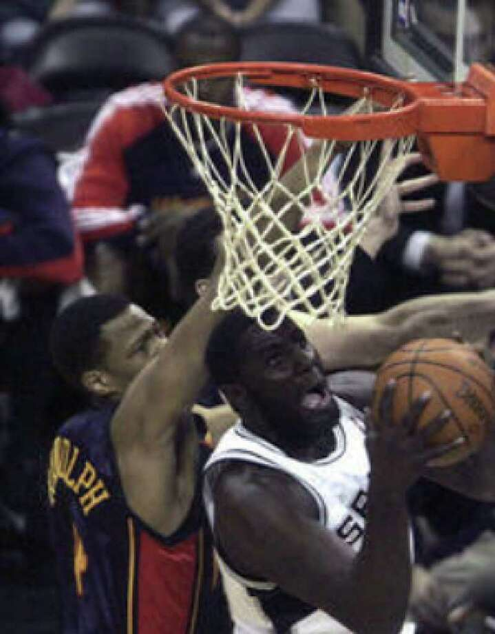 Spurs forward DeJuan Blair drives to the hoop past Golden State's Anthony Randolph during the second half Wednesday at the AT&T Center. Blair had five points and three rebounds.