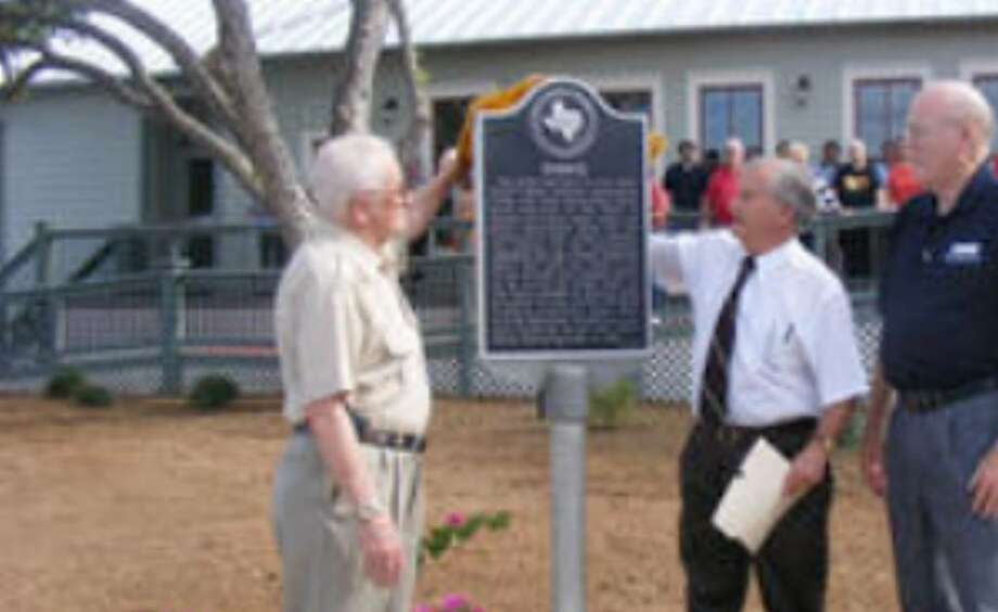 Unveiling a historic plaque outside the Kramer House are (from left) former Mayor Earl Sawyer, Schertz Historical Preservation Committee member Tom DeKunder, and current Mayor Hal Baldwin.