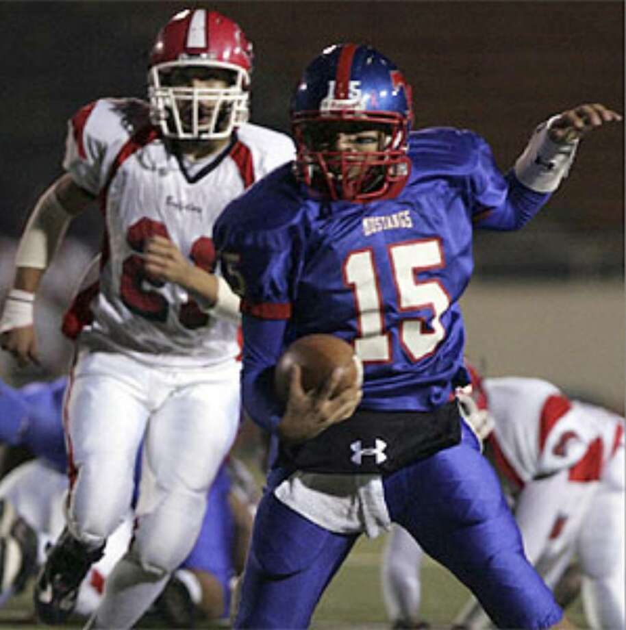 Jefferson quarterback Samuel Barron runs the ball in the first half against Fox Tech. Barron accounted for seven touchdowns — five passing and two rushing — in a 47-0 victory.