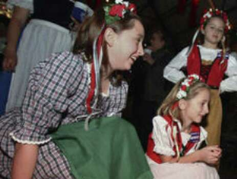 Bowden Zipp (right) shows his lederhosen to sisters (from left) Madeleine, Annalise and Karlina Hindman.