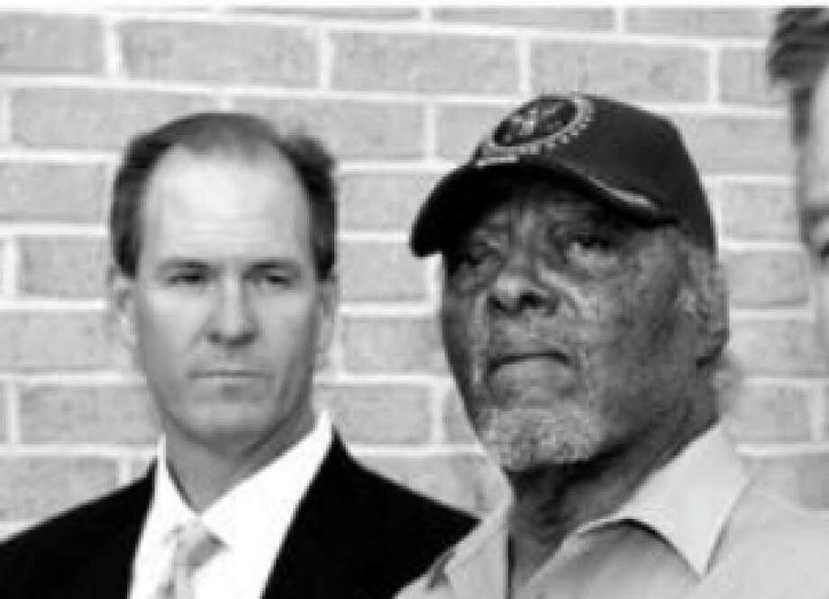 Willis Willis (center) arrives for a meeting with his attorneys, Sean Breen (left) and Randy Howry, at the Texas Lottery Commission.