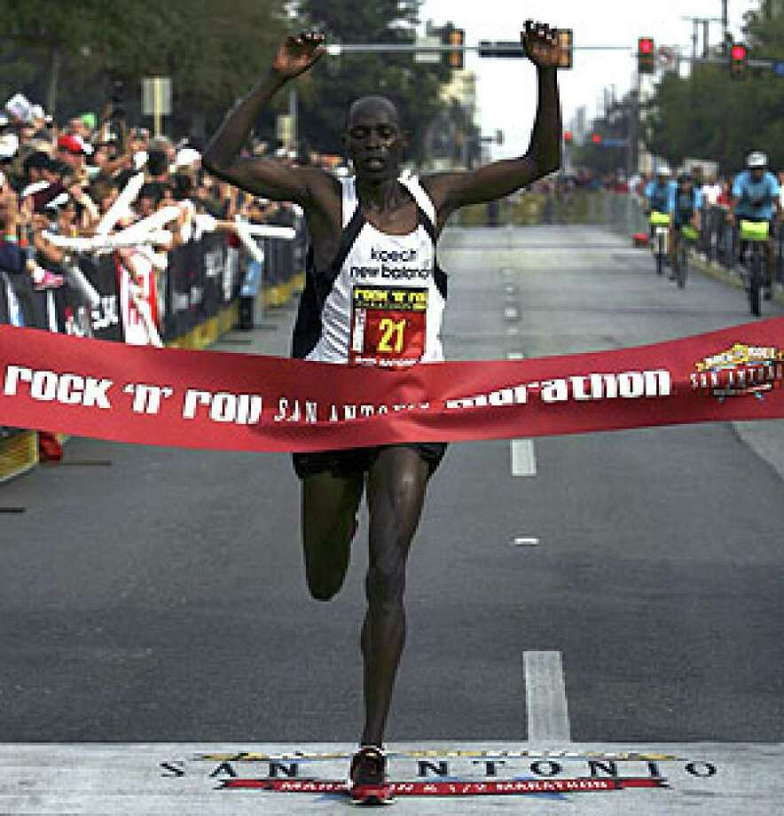 Gilbert Koech of Kenya was the overall winner of the Rock 'n' Roll San Antonio Marathon with a time of 2:14:39, leading a Kenyan sweep of the top five men's spots.