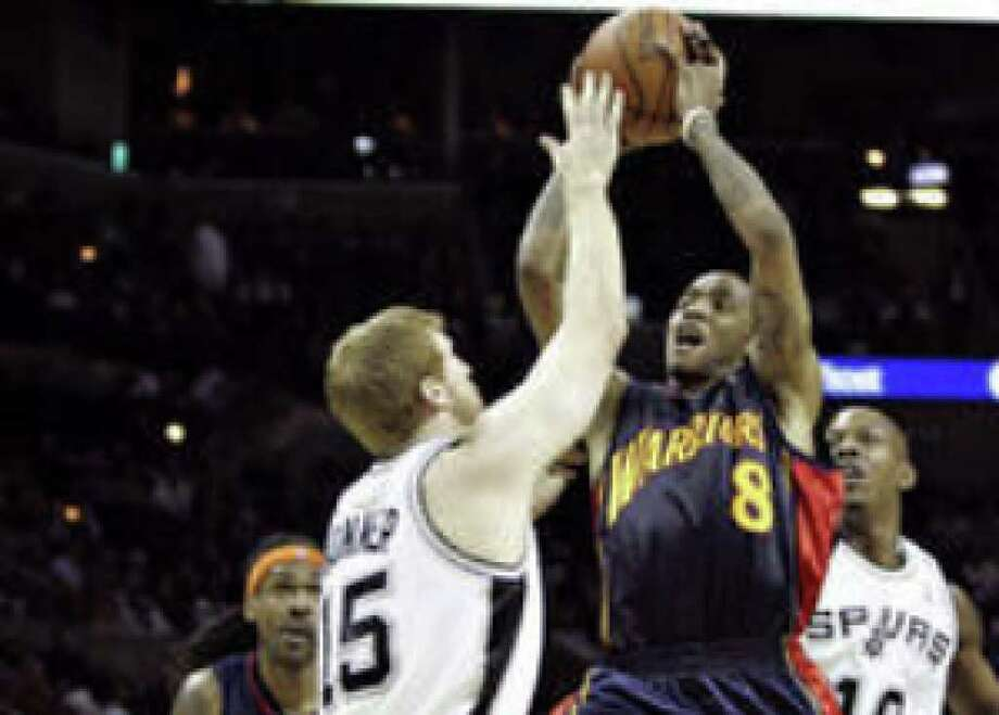 Matt Bonner of the Spurs (left) tries to keep Golden State's Monta Ellis from driving to the basket in the second half.